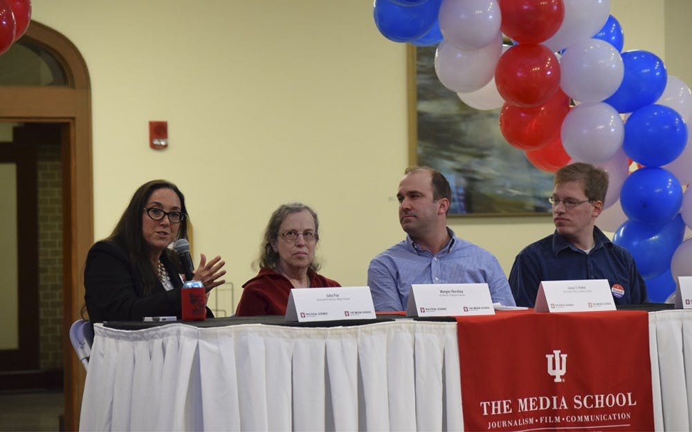 The first panel discussion at the Media School watch party in Franklin Hall, Tuesday night. Panelists (left to right) were: Julia Fox, associate professor in the Media School, Marjorie Hershey, professor in the Department of Political Science, Jason Peifer, assistant professor in the Media School and graduate student Edo Steinberg.