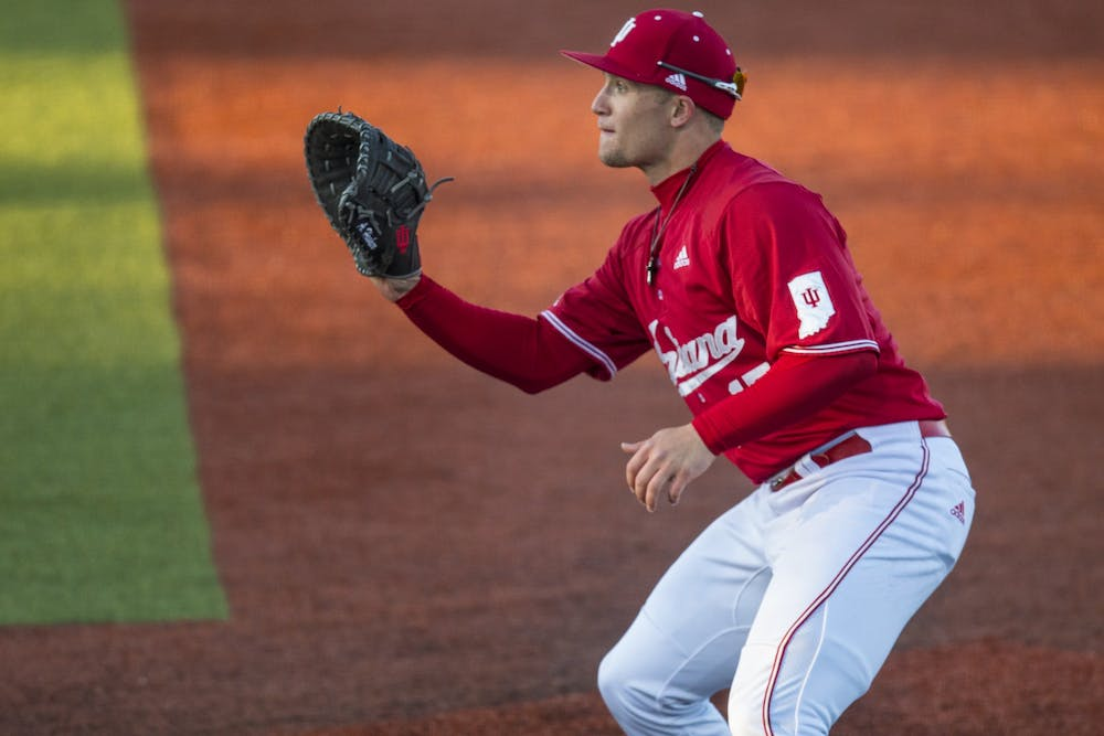 <p>Junior Elijah Dunham prepares to catch the ball at first base March 7 at Bart Kaufman Field. In the 15 games the Hoosiers played before the season was canceled, Dunham recorded 59 at bats, seven doubles and a .493 on base percentage.</p>
