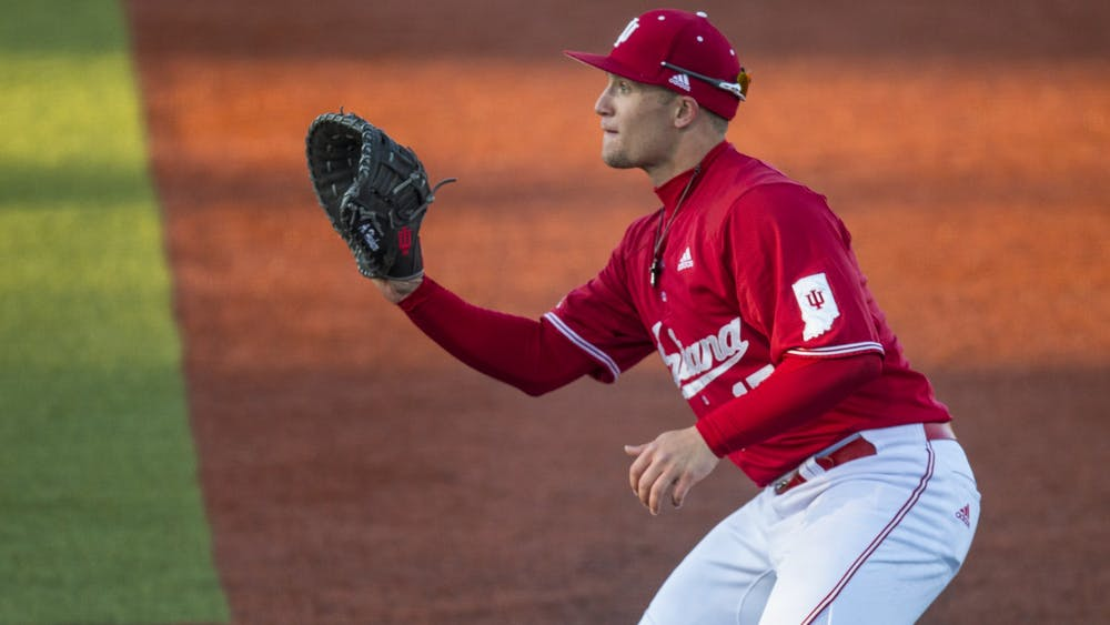 Junior Elijah Dunham prepares to catch the ball at first base March 7 at Bart Kaufman Field. In the 15 games the Hoosiers played before the season was canceled, Dunham recorded 59 at bats, seven doubles and a .493 on base percentage.