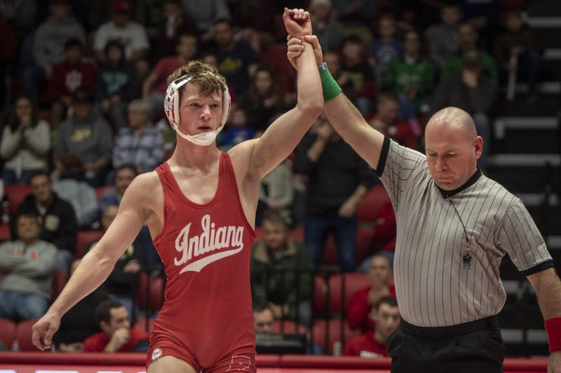 Redshirt freshman Graham Rooks faces the crowd Jan. 20 in Wilkinson Hall after defeating his opponent. Rooks was named Big Ten Wrestler of the Week on Jan. 21.