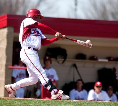 IU third baseman Micah Johnson hits a leadoff double July 22, 2018, during the Hoosiers' 7-3 win over Taylor University at Sembower Field.
