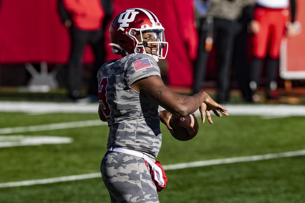 <p>Redshirt sophomore quarterback Michael Penix Jr. prepares to throw the ball Nov. 28 at Memorial Stadium. Penix will miss the rest of the season with a torn ACL.</p>