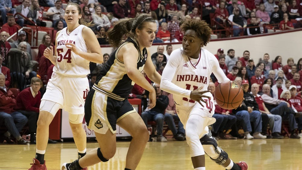 Freshman Chanel Wilson dribbles the ball around a Purdue defender Jan. 9 in Simon Skjodt Assembly Hall. IU women's basketball dropped to No. 20 in the AP Poll on Monday.