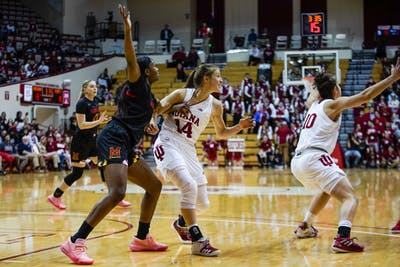 Redshirt junior guard Ali Patberg fights to defend senior Kaila Charles on Feb. 6 in Simon Skjodt Assembly Hall. Patberg scored 29 points in the Feb. 22 game against Minnesota.