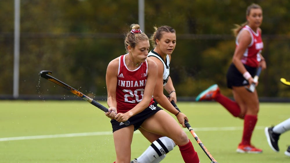 Senior forward Maddie Latino takes a shot against Michigan State on Oct. 15 at the IU Field Hockey Complex. Latino scored the final goal for IU this season in a loss to Ohio State.