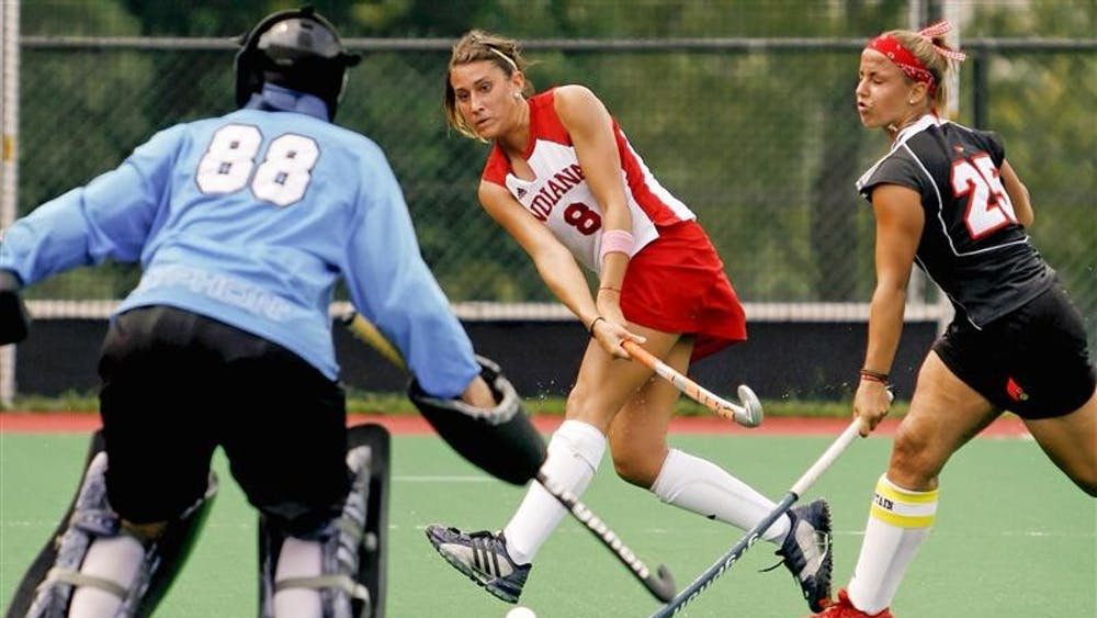 Junior forward Alina Valenti takes a goal shot during the Hoosiers 4-1 scrimmage loss to Louisville Aug. 24 at the IU Field Hockey field.