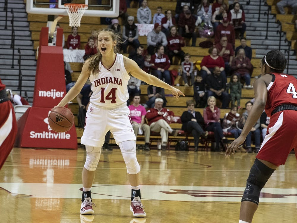 Junior Ali Patberg points at an open area on the court Feb. 27 in Simon Skjodt Assembly Hall. Patberg led the Hoosiers to victory over the Wolverines on March 1 with 21 points.
