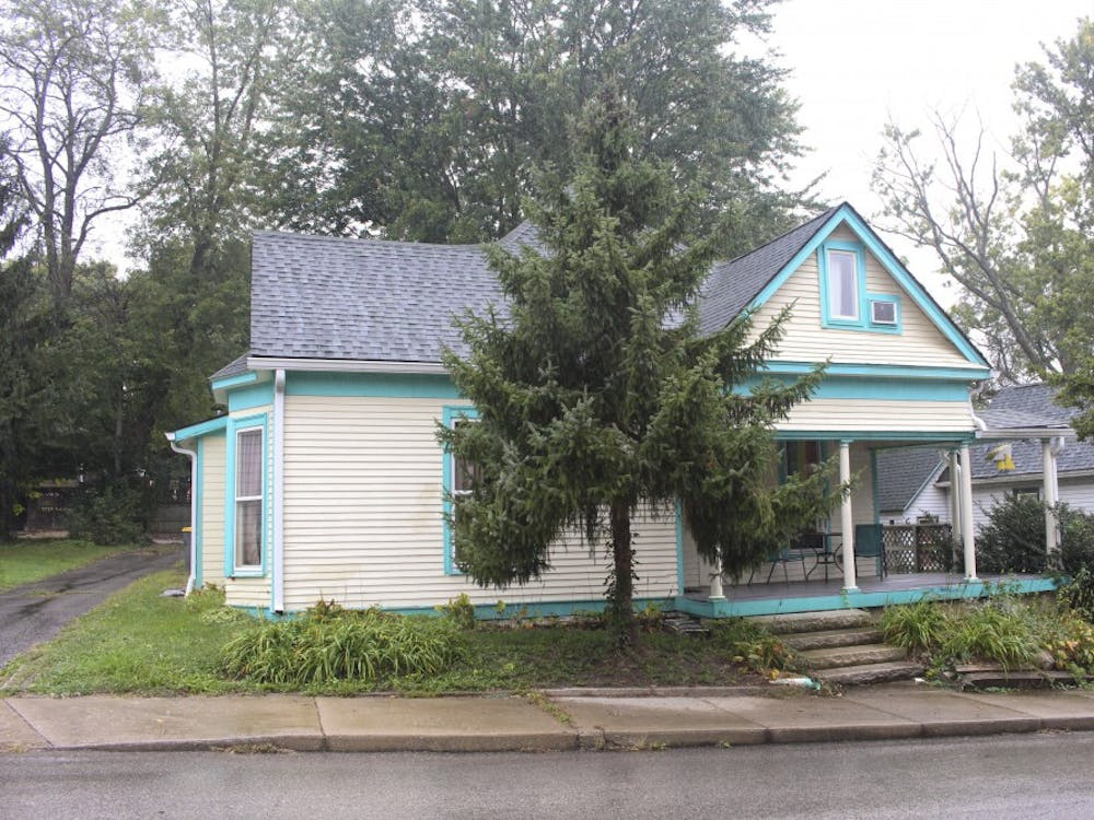 Paul Mahern lives in an off-white and teal house in Bloomington.