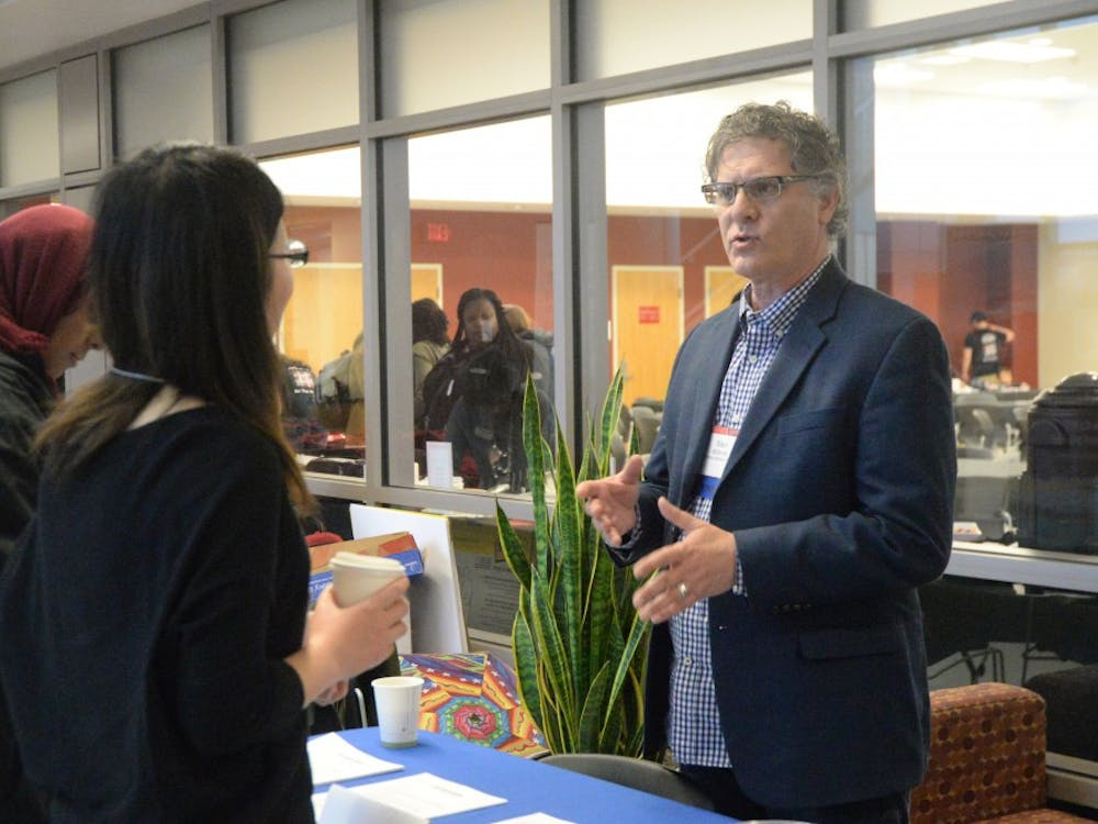 Shaun McDermott from Cornerstone Information Systems talks to students about his company during the CEWiT summit in Union Street Center. The CEWiT summit took place Friday and Saturday and was open to IU students and community members.