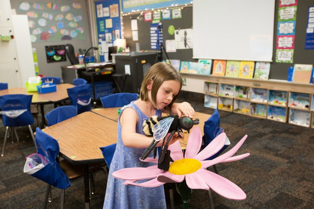<p>Students in Tabitha Bow's Clear Creek Elementary School class use BioSim technology to help a researcher gather data on May 14.</p>