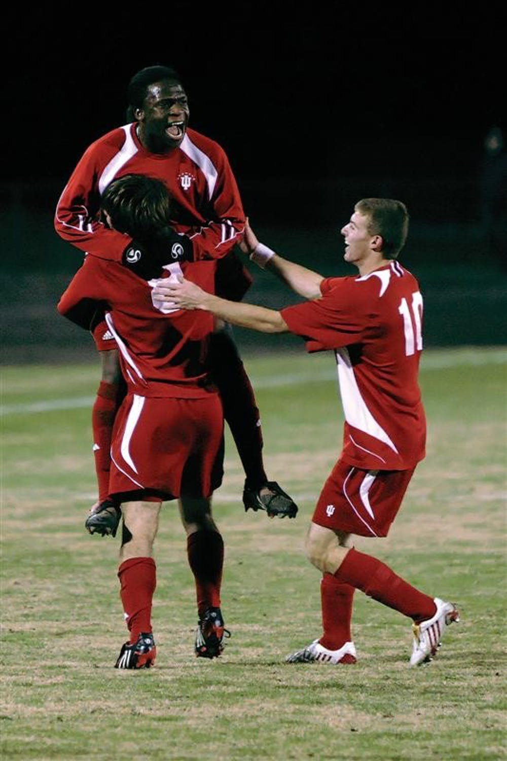 Senior midfielder John Mellencamp (8) celebrates with teammates Ofori Sarkodie and Andy Adlard (10) following Mellencamp's goal in the 18th minute of the Hoosier's 2-0 win over St. Louis on Tuesday night at Bill Armstrong Stadium. IU advances to the third round of the NCAA tournament where the team will play host to Michigan at 7 p.m. Saturday.