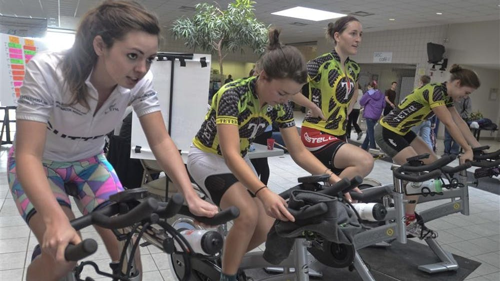 Teter Little 500 riders freshman Ashton Dehahn, left, senior Susan Laurie, sophomore Emma Coughlin and senior Lisa Hutchenson warm up on sationary bikes Saturday at the Student Recreational Sports Center. Teams competed to see who could produce the most energy by cycling.