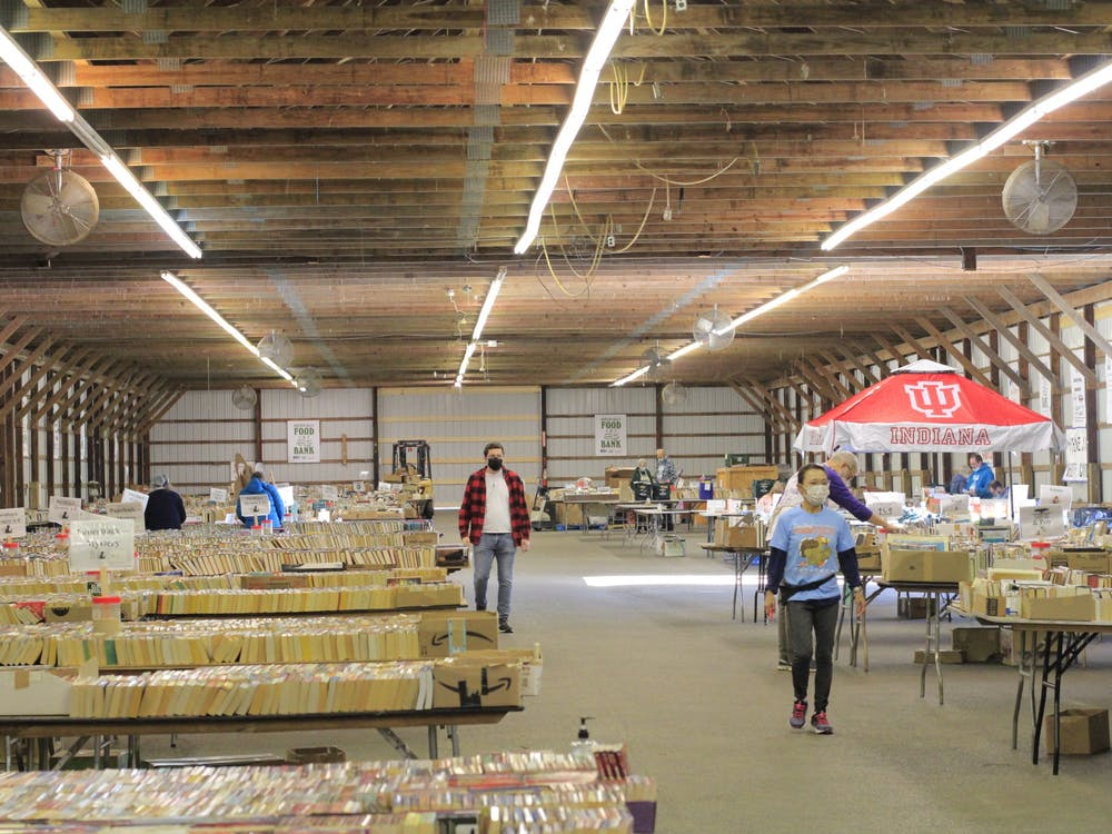 People walk around the Hoosier Hills Book Fair on Oct. 18, 2021, at the Monroe County Fairgrounds. The Hoosier Hills Food Bank organized a six-day book fair event starting Oct. 14 at the Monroe County fairgrounds.