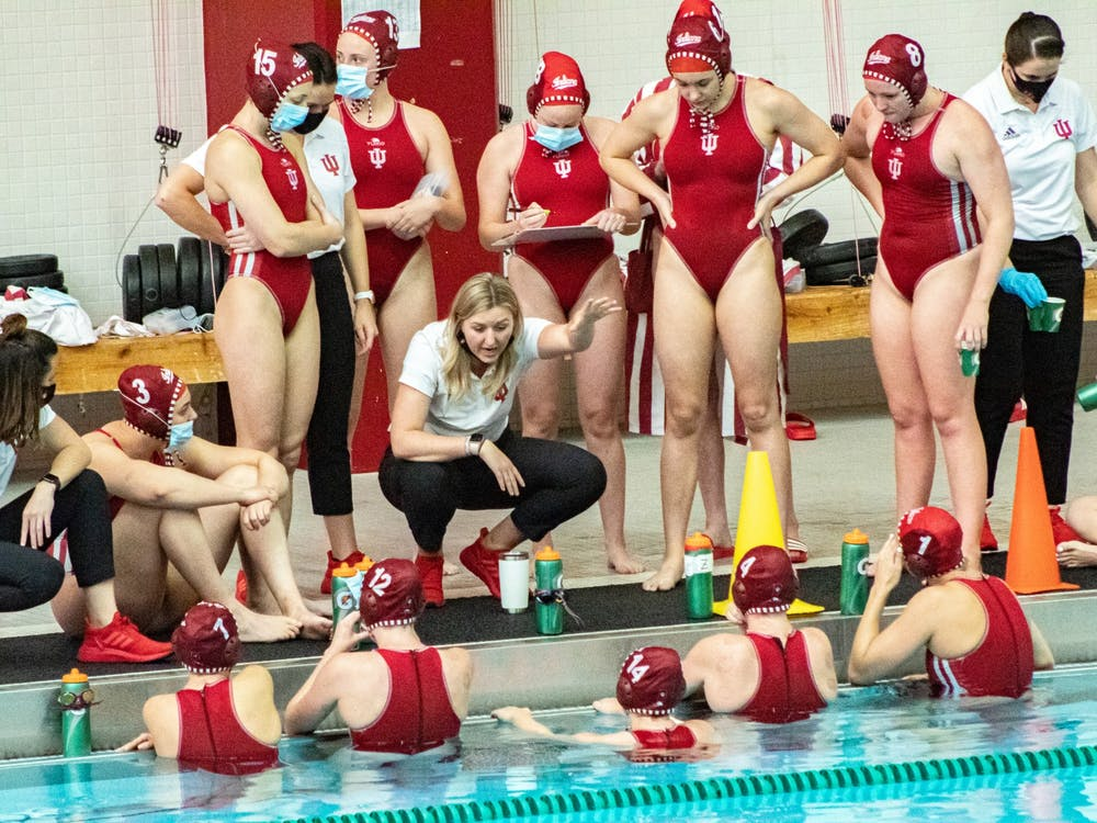 IU water polo head coach Taylor Dodson talks to the team April 13 at the Counsilman-Billingsley Aquatics Center. The Hoosiers will play a two-match series against No. 4 University of California, Berkeley, this weekend in Berkeley, California