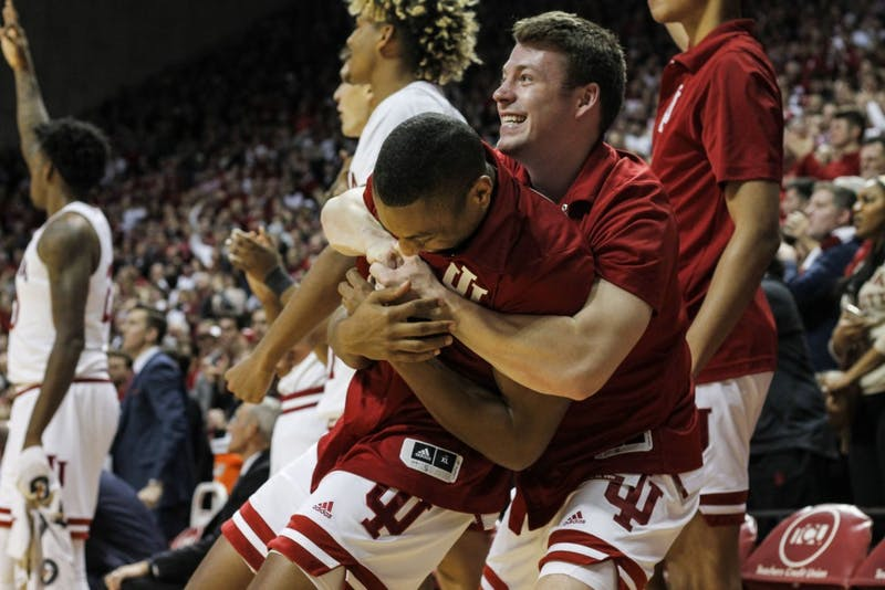 Junior guard Johnny Jager hugs senior guard Quentin Taylor after IU takes the lead against University of Louisville on Dec. 8 at Simon Skjodt Assembly Hall. IU defeated Louisville 68-67.