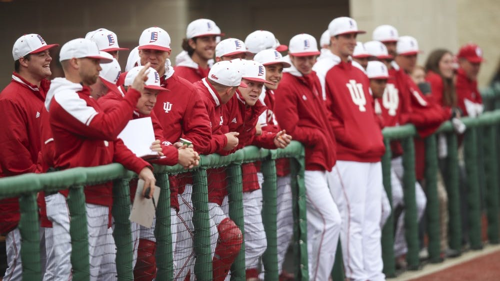 The IU dugout watches an IU at-bat during the game against Indiana State on April 10 at Bart Kaufman Field.