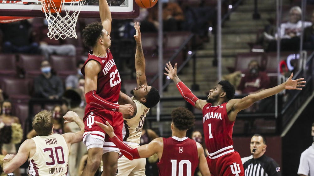 Sophomore Trayce Jackson-Davis goes up to block a Florida State University shot Dec. 9 at the Donald L. Tucker Civic Center in Tallahassee, Florida. IU men's basketball plays Butler University on Saturday in the Crossroads Classic.