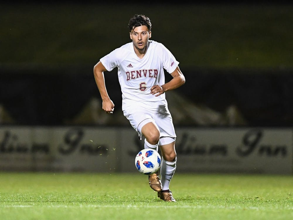 Callum Stretch dribbles the ball across the field. Stretch announced his transfer to IU from the University of Denver for his junior season in mid-March.