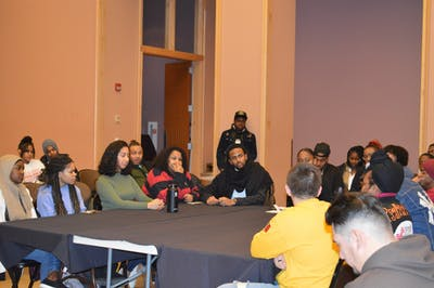 Members sit at a table during The U.N.I.T.Y A Black And Brown Panel  put on by the Black Student Union and Lambda Upsilon Lambda on Feb. 18 at the Neal-Marshall Black Culture Center.
