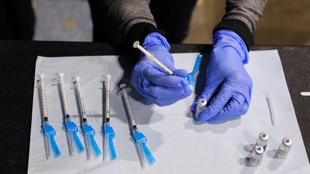 Corinne Puchalla, a pharmacist with the University of Illinois at Chicago College of Pharmacy, prepares the Pfizer COVID-19 vaccine on Feb. 8 in Chicago. More than 500 people participated in IU's AstraZeneca COVID-19 vaccine study.