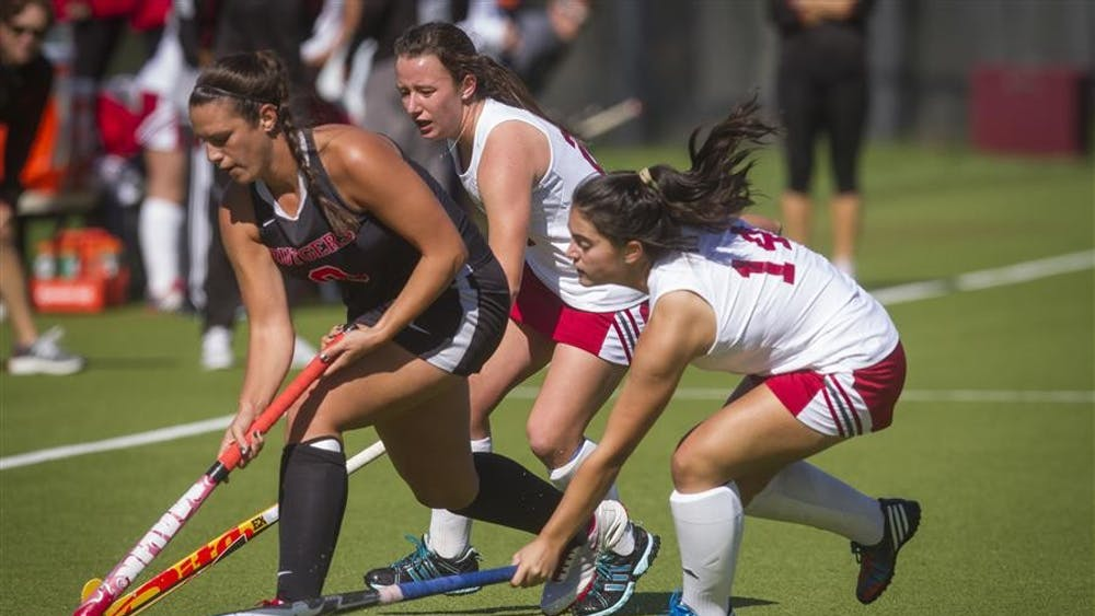 The Hoosiers try to steal the ball from a Rutgers offender Sunday afternoon at the IU Field Hockey Complex.