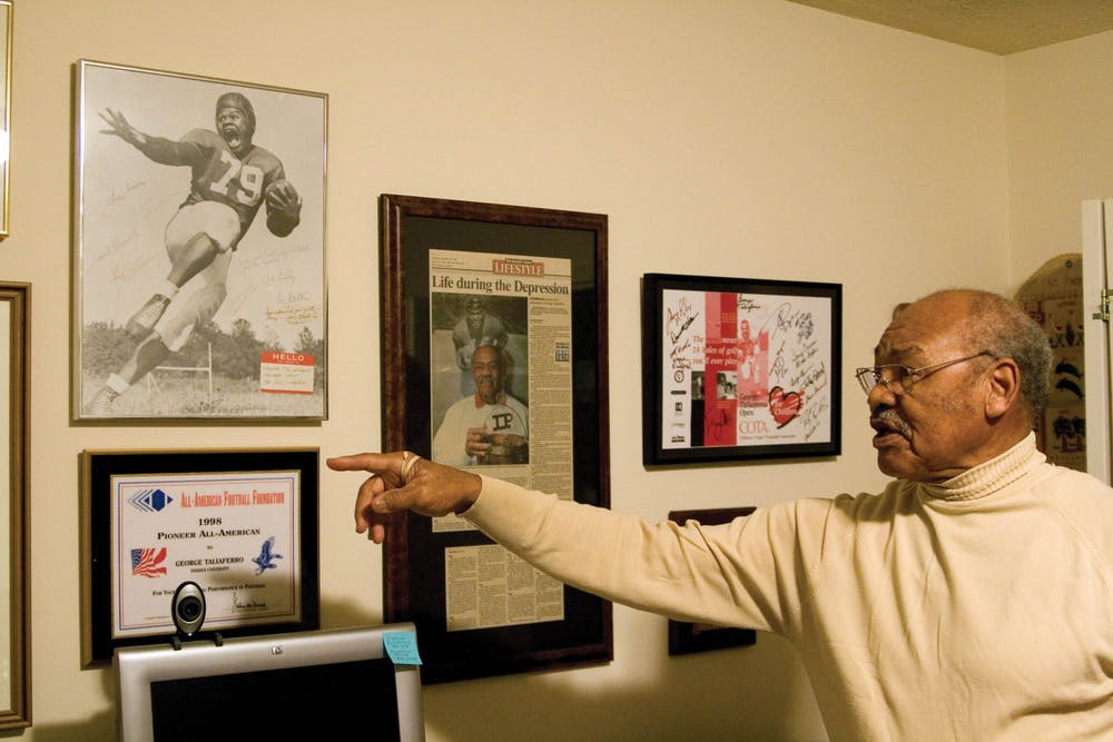 George Taliaferro points to his recognitions and awards on the wall in his Bloomington home in 2007. Big Ten commissioner Kevin Warren announced the creation of the George and Viola Taliaferro Scholarship on Thursday.