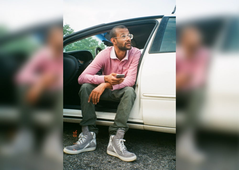 <p>Alonzo Amos V sitting in a car speaking with his friends. Amos died June 18, 2020.</p>