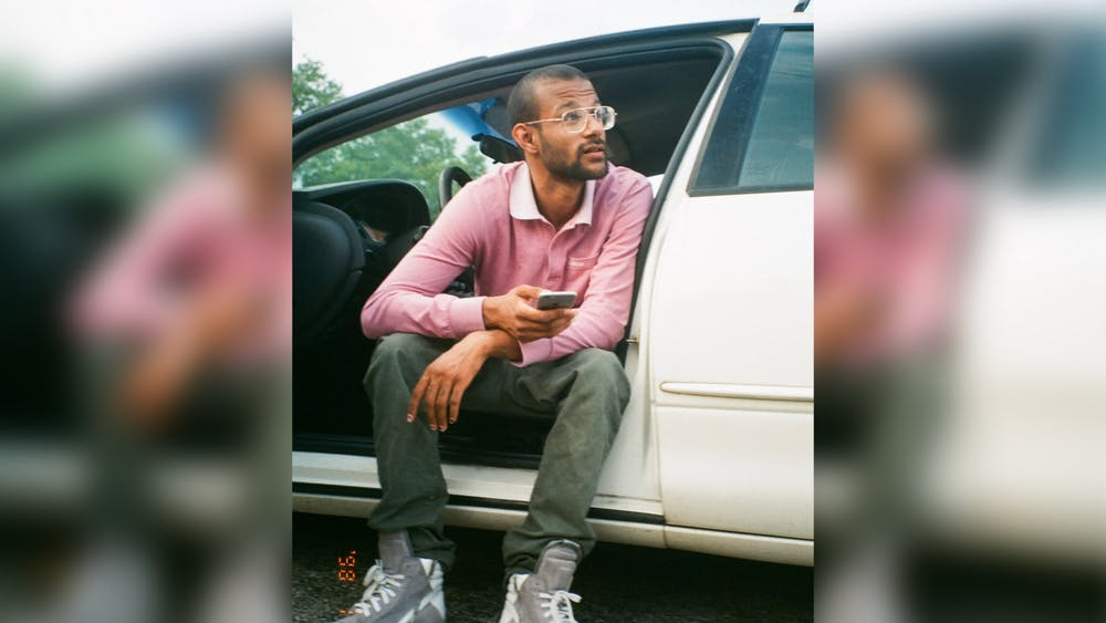 Alonzo Amos V sitting in a car speaking with his friends. Amos died June 18, 2020.
