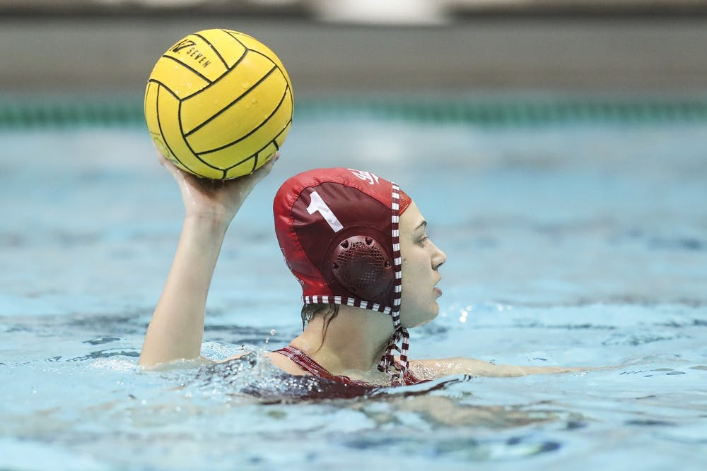<p>Then-sophomore goalkeeper Mary Askew makes a pass Jan. 20, 2020, in the Counsilman-Billingsley Aquatics Center. Askew had 15 saves in two games against USC on April 1 and 2.</p>
