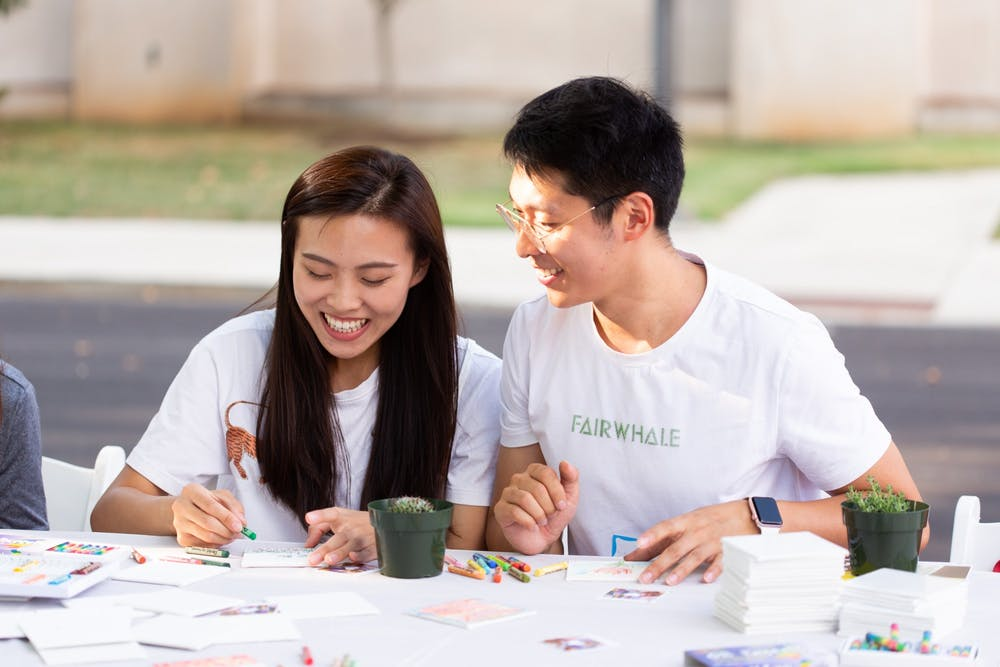 <p>Two students participate in activities at 2019 CultureFest.</p>