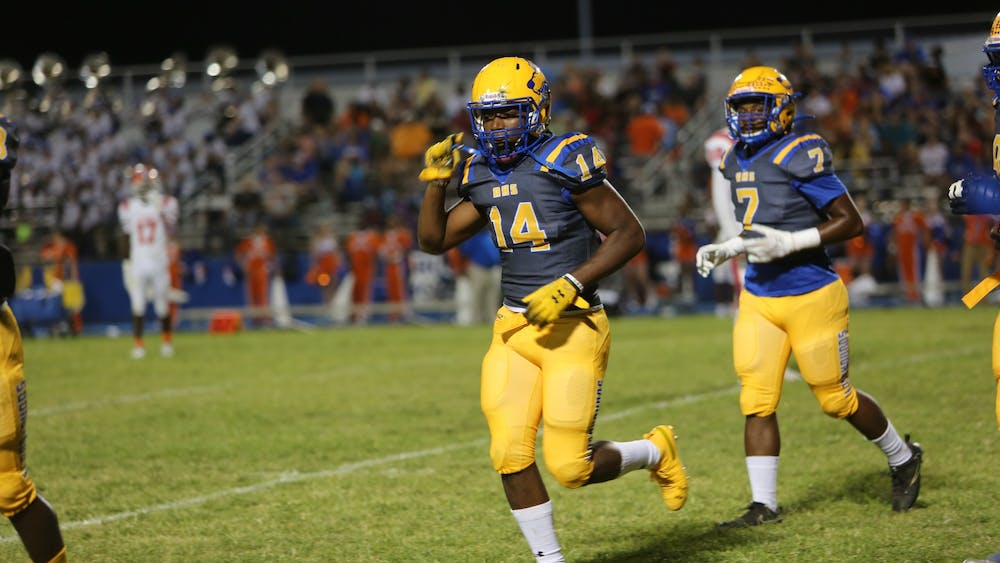 No. 14 Aubrey Burks jogs off the field during a game for Auburndale High School in Auburndale, Florida. Burks is ranked No. 761 nationally in the 2021 class.