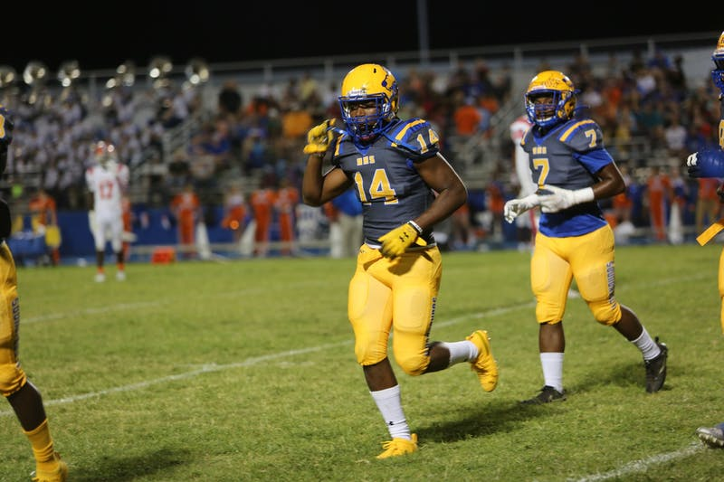 <p>No. 14 Aubrey Burks jogs off the field during a game for Auburndale High School in Auburndale, Florida. Burks is ranked No. 761 nationally in the 2021 class.</p>