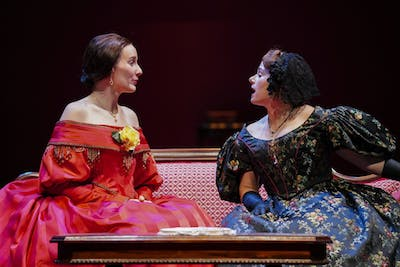 "Catherine Sloper, left, and aunt Lavinia Penniman, right, portrayed by Glynnis Kunkel-Ruiz and Ellise Chase, socialize before a party during a rehearsal of Ruth and Augustus Goetz ""The Heiress"" on Sept. 18 in Ruth N. Halls Theatre. The story focuses on Catherine Sloper, a wealthy, socially awkward woman who falls in love with a man that her father believes is only after their money."