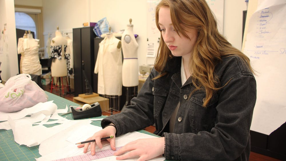 Junior Meredith Higgins, a fashion design major, sketches her pieces Feb. 24 in Kirkwood Hall. Higgins designed a fashion line for her senior collection.