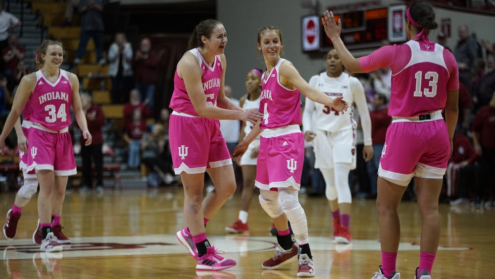 Red shirt junior Ali Patberg is cheered on by her teammates after scoring a 3-pointer during the last minute of overtime Jan. 30 at Simon Skjodt Assembly Hall. Patberg scored 20 of IU's 75 points.