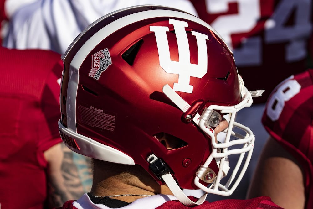 <p>A social justice logo is displayed on the back of an IU football helmet Oct. 24 in Memorial Stadium. The Old Oaken Bucket game has been rescheduled and will take place at 7:30 p.m. Friday in Bloomington.</p>