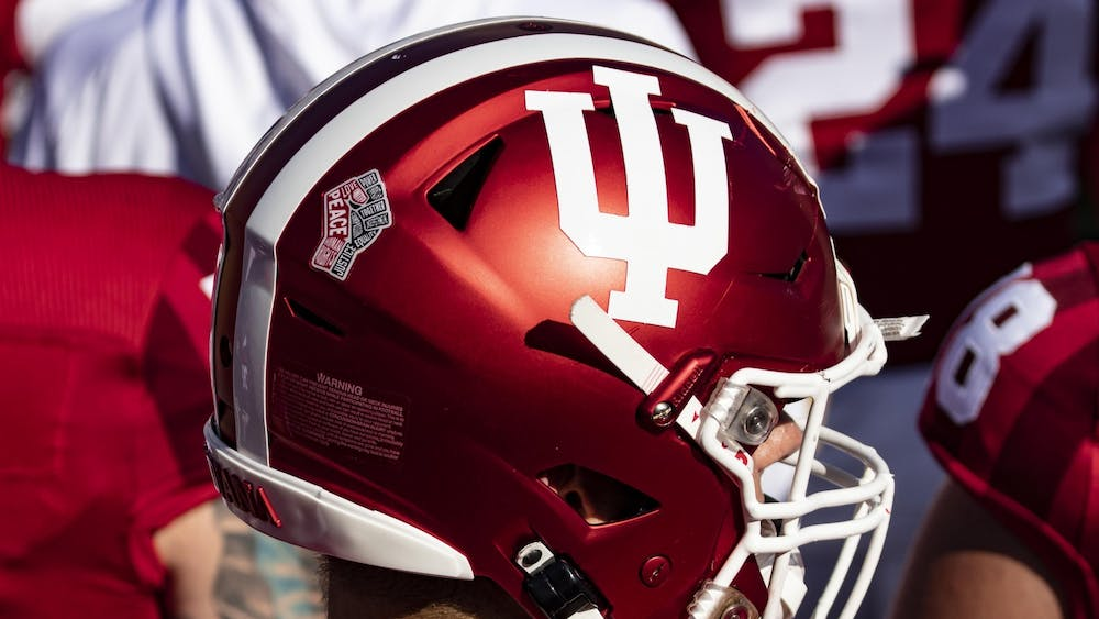 A social justice logo is displayed on the back of an IU football helmet Oct. 24 in Memorial Stadium. The Old Oaken Bucket game has been rescheduled and will take place at 7:30 p.m. Friday in Bloomington.