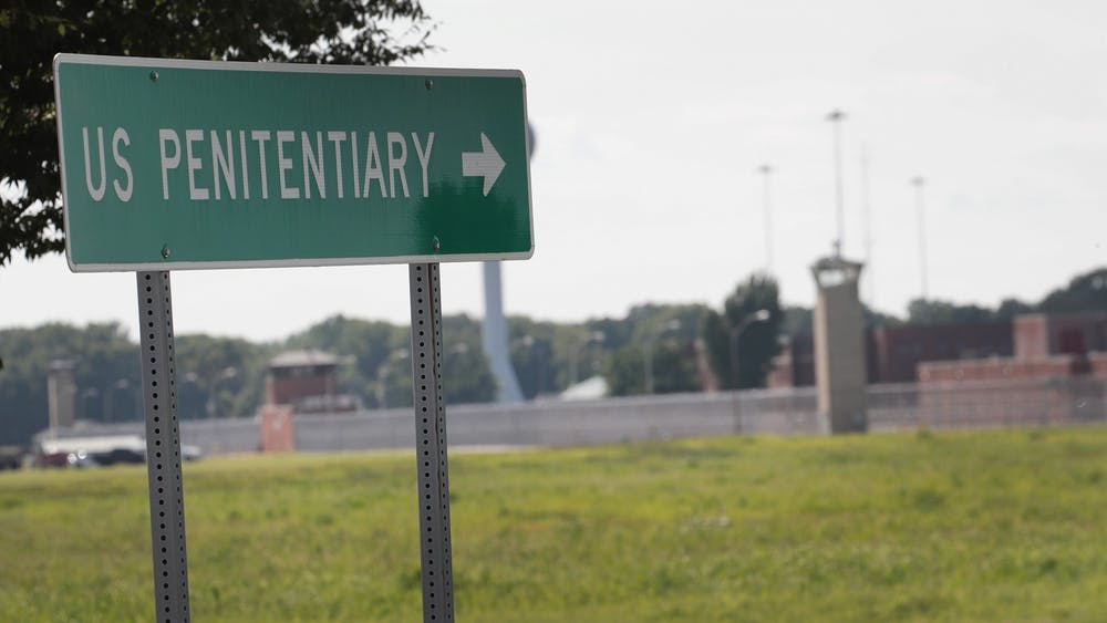 A sign directs visitors to the entrance of the Federal Correctional Complex, Terre Haute on July 25, 2019, in Terre Haute, Indiana. WTIU and WFIU reporters tested positive for COVID-19 after covering the Trump administration's federal executions there.