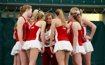 The IU women's tennis team huddles Feb. 19, 2017, before a morning match against University of Notre Dame. IU will play Nebraska on March 29.