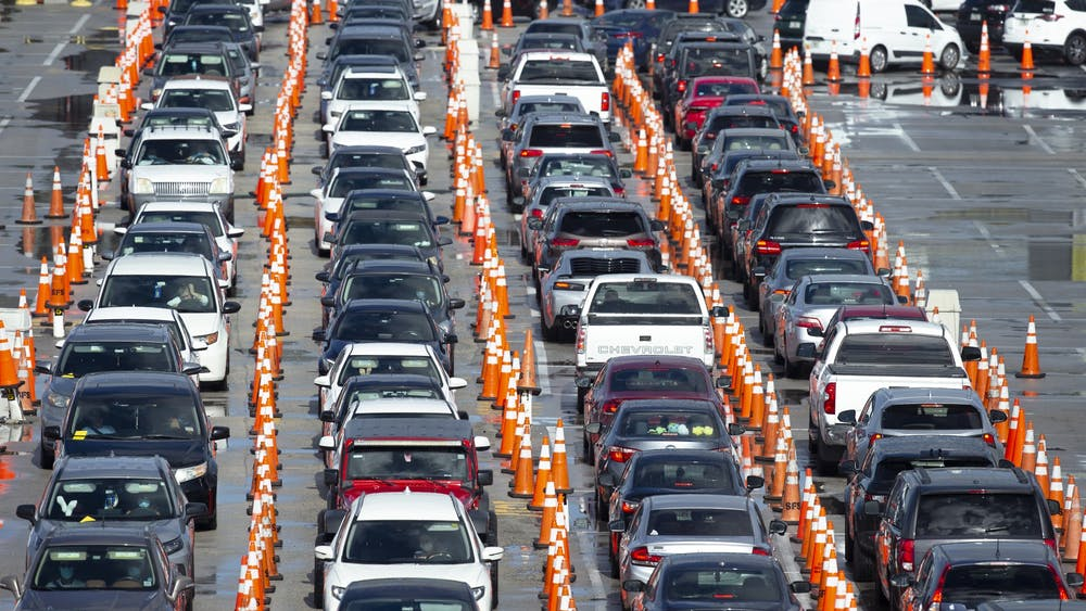Vehicles line up July 19 at the COVID-19 drive-thru testing center at Hard Rock Stadium in Miami Gardens.