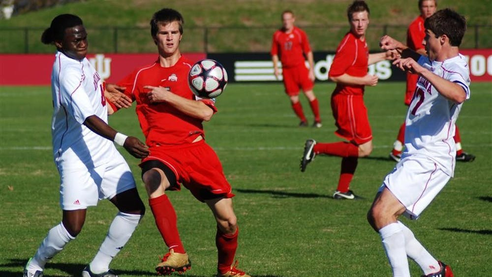 Senior back Ofori Sarkodie, Ohio State's Doug Verhoff and senior midfielder Lee Hagedorn brace for the ball near the Hoosier goal