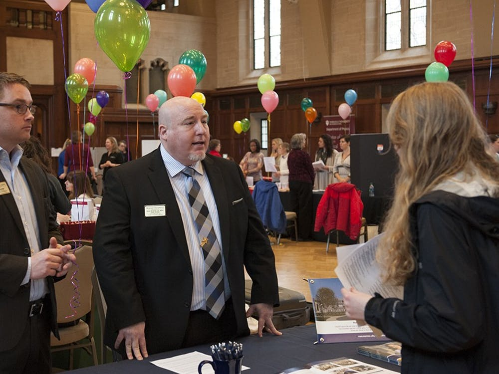 Dan Kellenberger (left), Assistant Director Marketing, Recruitment and Admissions and Dr. Patrick Woodman, DO (right) of Marian University speaking to one of the attendees of the Health Programs Fair held on Tuesday at the Alumni Hall in the IMU