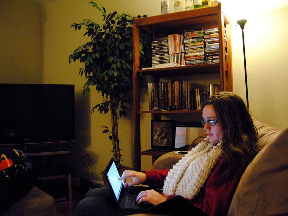 """In her apartment, Emily reviews her social work class assignment. She plans to finish her undergraduate degree in the spring and start graduate school in the fall. """"I want them to get a glance into my world,"""" she said. """"You probably don't carry your keys with you as a weapon walking to your car."""""""
