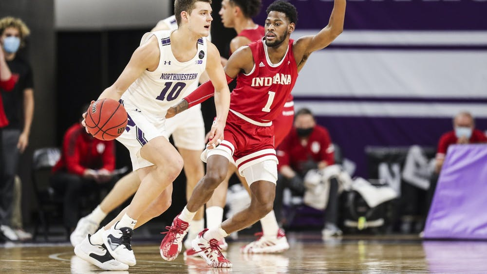Sophomore forward Armaan Franklin defends against the Northwestern offense Wednesday in Welsh Ryan Arena in Evanston, Illinois. IU defeated Northwestern 79-76 in double overtime.