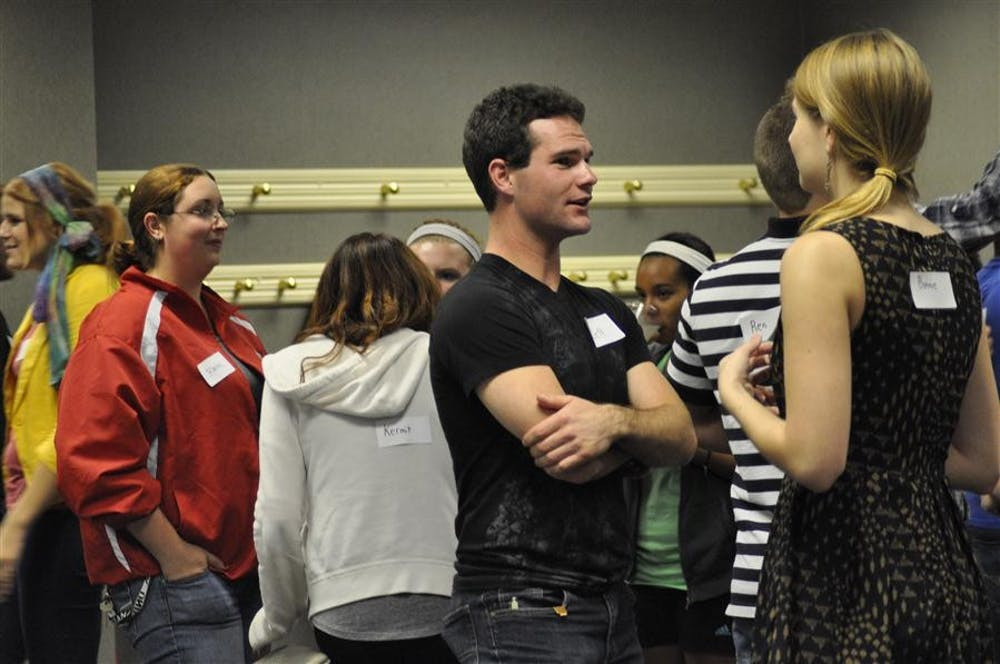 """<p>Senior Jeff Tippin mingles with other students at the Speed Dating event organized as the kick-off of Sexploration week by the IU Health Center on Oct. 1, 2012&nbsp;at the IMU State Room East. The health center and the IU Auditorium will collaborate on the 2016&nbsp;Sexploration panel discussion in anticipation for """"Rent,"""" coming to the Auditorium.</p>"""