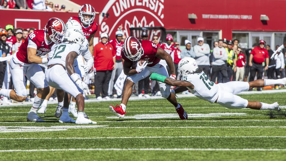 Graduate running back Stephen Carr sheds a tackle Oct. 16, 2021 at Memorial Stadium. Indiana lost to Michigan State 20-15.