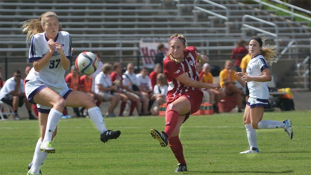 Red shirt junior midfielder Kayleigh Steigerwalt strikes the ball during the game against Northwestern University at Bill Armstrong Stadium. IU tied the game 1-1.