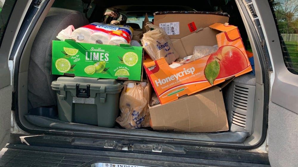 Groceries and supplies given by the South Central Community Action Program's Thriving Connections are loaded into the back of a car ready to be delivered to families in need. Consumers use delivery services like Shipt and Instacart to avoid visiting shops and other places where it's easy to spread the coronavirus.