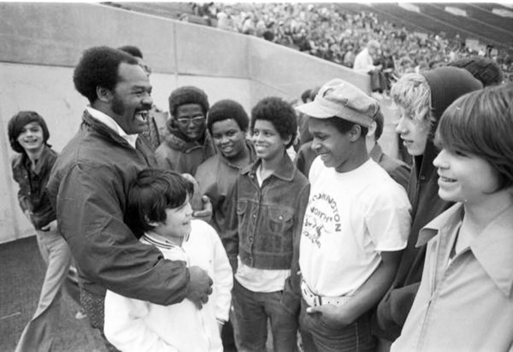 George Taliaferro talking with children at an IU football game in 1973.