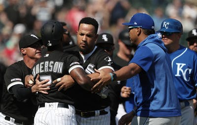 Chicago White Sox shortstop Tim Anderson, No. 7, is held back by teammate Jose Abreu after being hit by a pitch from Kansas City Royals pitcher Brad Keller in the sixth inning Wednesday at Guaranteed Rate Field in Chicago.